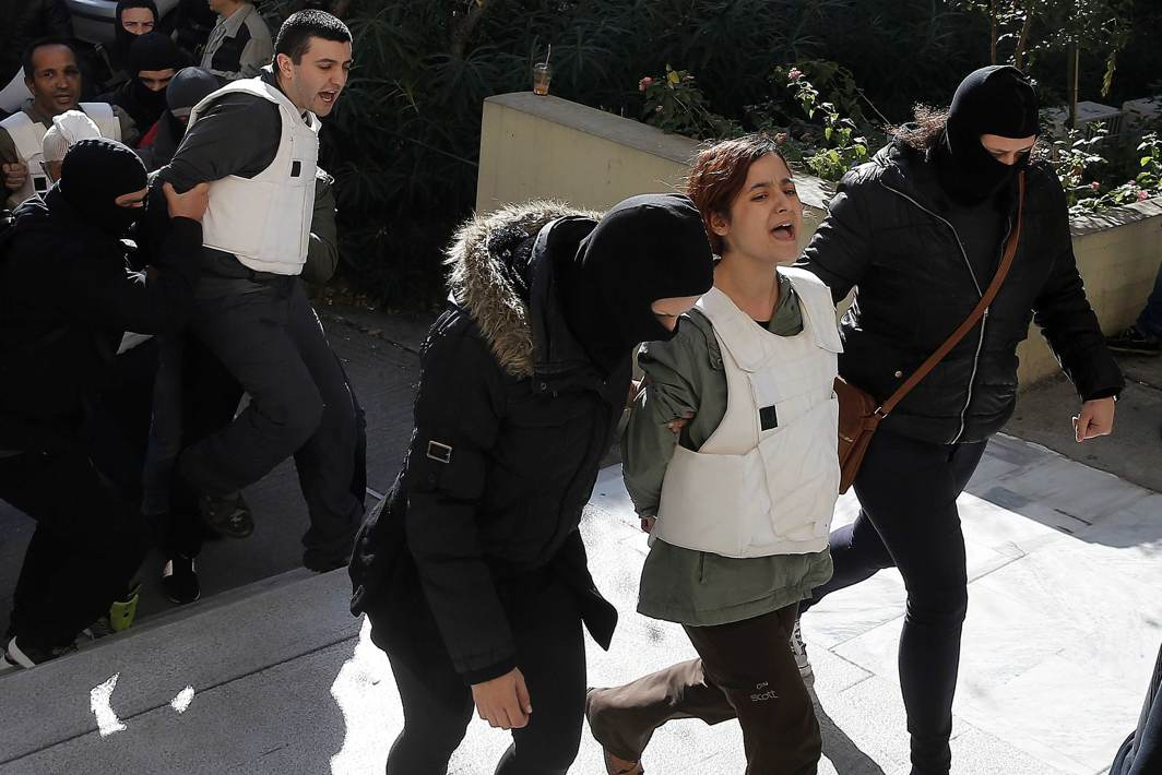 IN FOR THE LONG HAUL: Eight men and a woman holding Turkish citizenship, who were arrested on suspected links to a leftist militant group, are escorted by anti-terrorism police to the prosecutor's office in Athens, Greece, Reuters/UNI