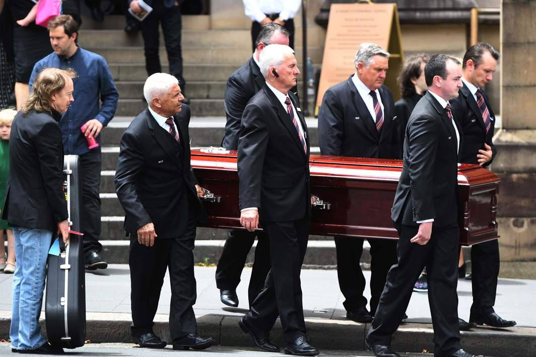GOODBYE: Angus Young holds a guitar as the casket of his brother AC/DC co-founder and guitarist Malcolm Young is carried to a hearse following his funeral at St Mary's Cathedral in Sydney, Dean Lewins/AAP/Reuters/UNI