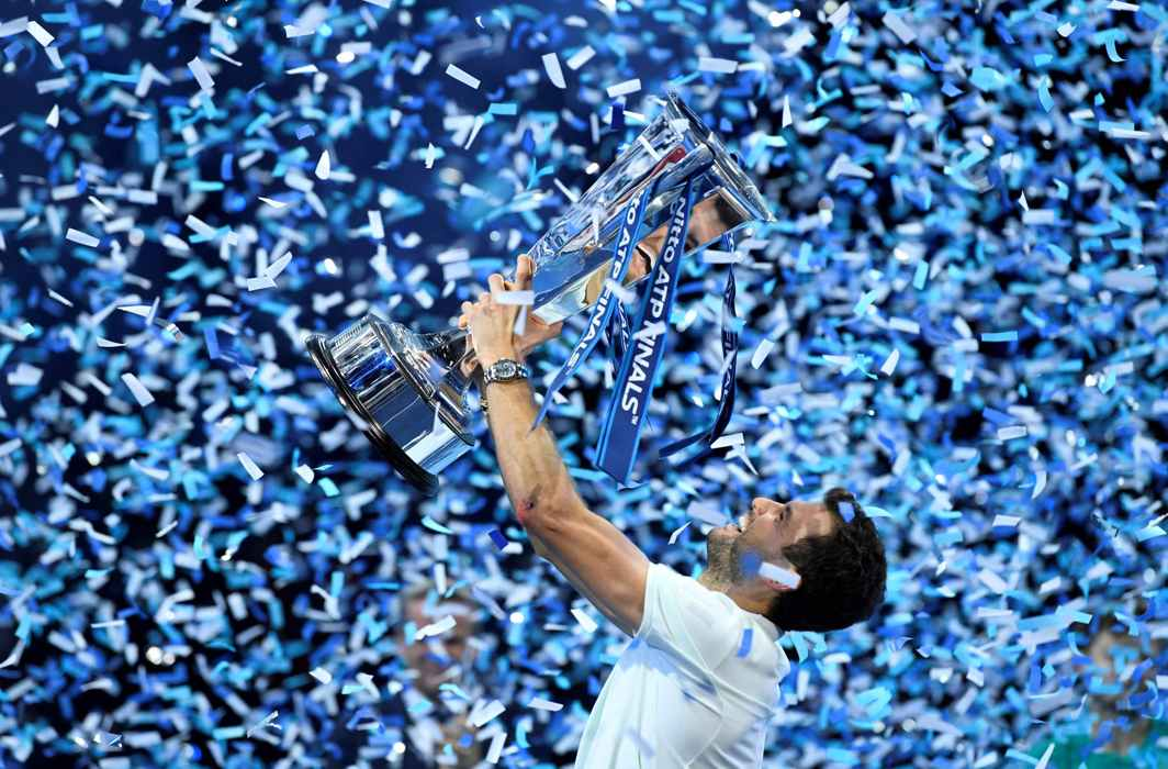 SWEET VICTORY WELL-EARNED: Bulgaria's Grigor Dimitrov celebrates with the trophy after winning the ATP World Tour final against Belgium's David Goffin in London, Reuters/UNI