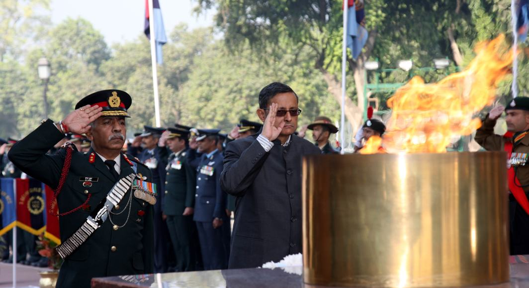 RESPECT: Defence secretary Sanjay Mitra with director general, NCC, pays tribute to martyrs at Amar Jawan Jyoti, India Gate, to mark the 69th NCC Day, in New Delhi, UNI