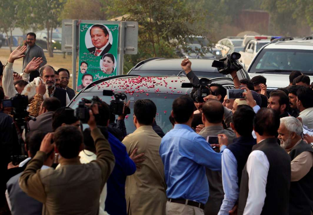 NAWAZ'S BOYS: Supporters surround a car transporting Pakistan's former Prime Minister Nawaz Sharif as he arrives to the accountability court to face the corruption references filed against him, in Islamabad, Reuters/UNI