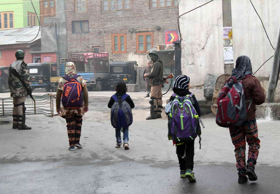 LESSONS ARE KEY: Schoolchildren on way to private tuition lessons amid curfew at Rajori Kadal in downtown Srinagar, UNI