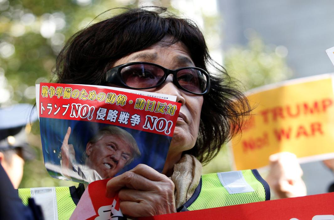 PUSH HARDER: A protester holds a poster during a rally against US President Donald Trump's visit to Japan, near the US Embassy in Tokyo, Japan, Reuters/UNI
