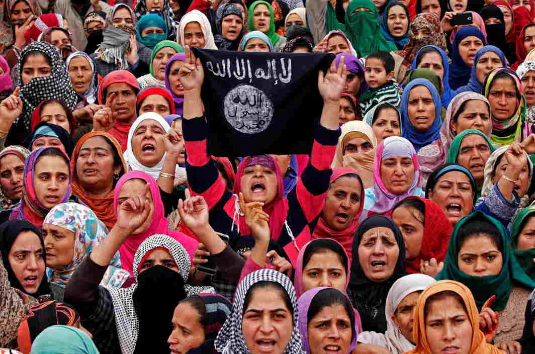 IN GRIEF: Women shout pro-freedom slogans as people carry the remains of Mugees Mir, a suspected militant who according to local media was killed in an encounter with the Indian security forces in Zakura, during his funeral in Srinagar, Reuters/UNI