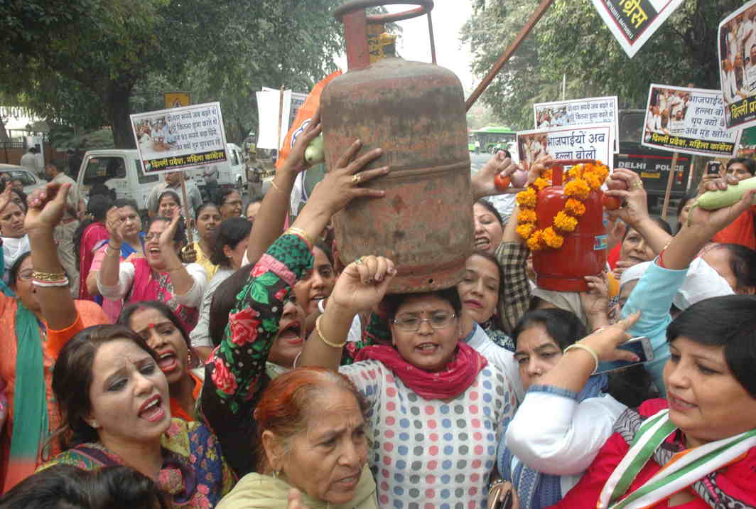 HEAVY LIFTING: Delhi Pradesh Mahila Congress activists raise slogans during a demonstration near the BJP headquarters in protest against the rising price of LPG and essential commodities, in New Delhi, UNI