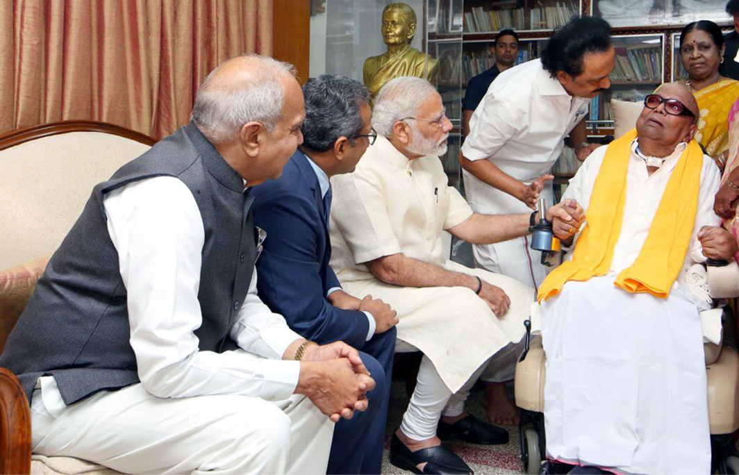 OLD AND NEW: Prime Minister Narendra Modi calls on DMK president M Karunanidhi at his Gopalapura residence, in Chennai, UNI