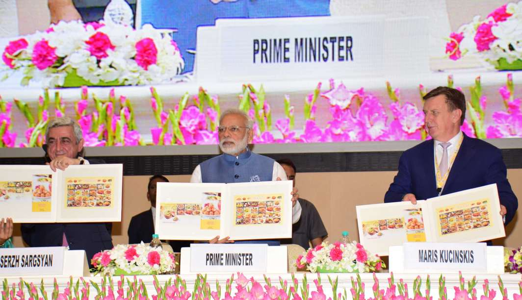 MAN OF GESTURES: Prime Minister Narendra Modi, with President of Armenia Serzh Sargsyan (L) and Prime Minister of Latvia Maris Kucinskis, releases commemorative postage stamps on food at World Food India 2017, in New Delhi, UNI