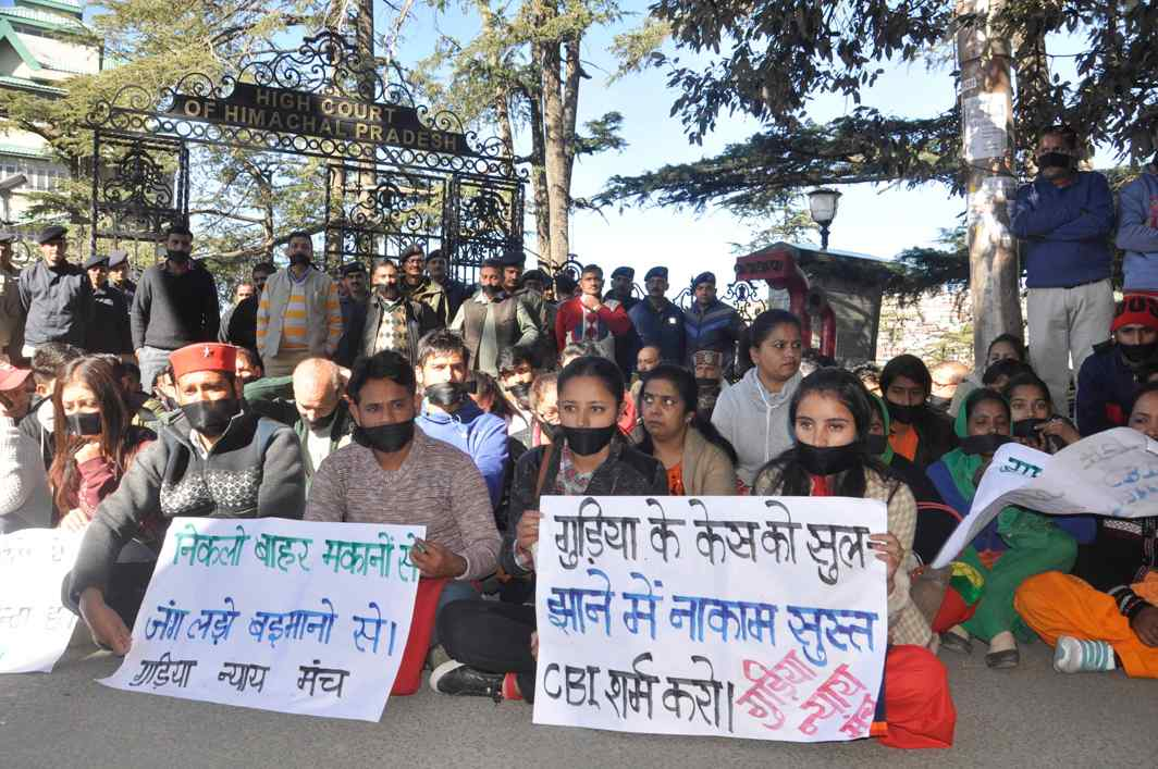 JUSTICE FOR GUDIYA: People under the banner of 'Gudiya Nyay Manch' stage a protest outside the Himachal Pradesh High Court in Shimla, UNI