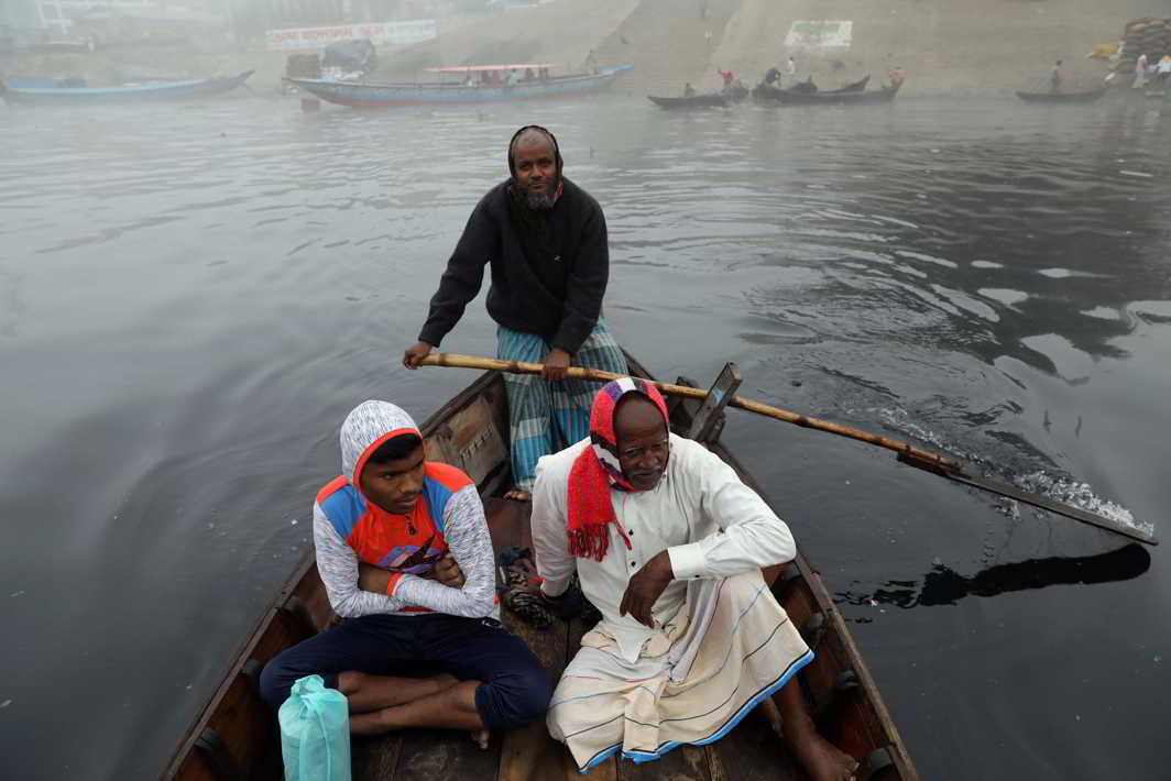 MORNING RIDE: People cross the Buriganga by boat on a winter morning in Dhaka, Bangladesh, Reuters/UNI