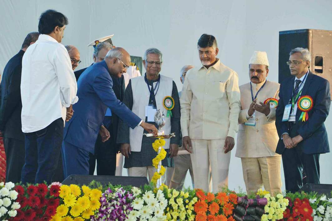 GIVE ME OIL: President Ram Nath Kovind lights the ceremonial lamp to inaugurate the Centenary Annual Conference of Indian Economic Association in Guntur, UNI