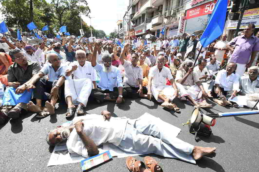 DIRE STRAITS: Kerala State Road Transport Corporation Pensioners' Organisation members stage a roadblock demanding pension arrears in front of the state secretariat, UNI