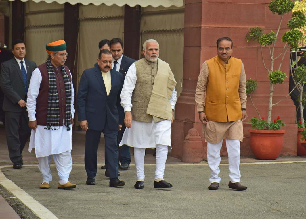 ON TOUR: Prime Minister Narendra Modi is received by Parliamentary Affairs Minister Ananth Kumar and Minister of State for Parliamentary Affairs Jitendra Singh and Arjun Ram Meghwal on arrival at Parliament House on the opening day of the winter session, in New Delhi, UNI