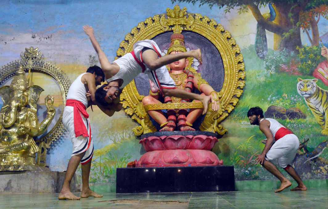 THAT'S HOW IT'S DONE: A martial artiste performs Kalarippayattu manuoevres at the Sannidhanam auditorium at the Sabarimala hill shrine, UNI