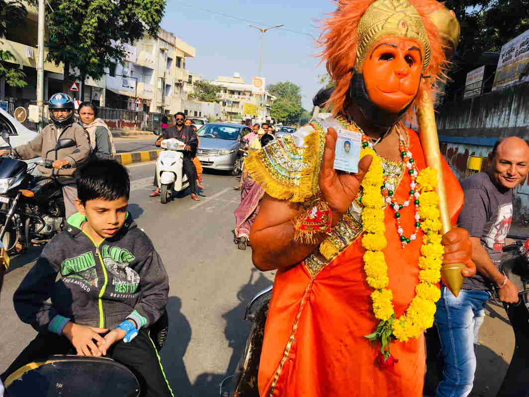 LORD'S LIEUTENANT: A man dressed as Lord Hanuman on way to cast his vote during second phase polling in the Gujarat assembly polls, in Ahmedabad, UNI