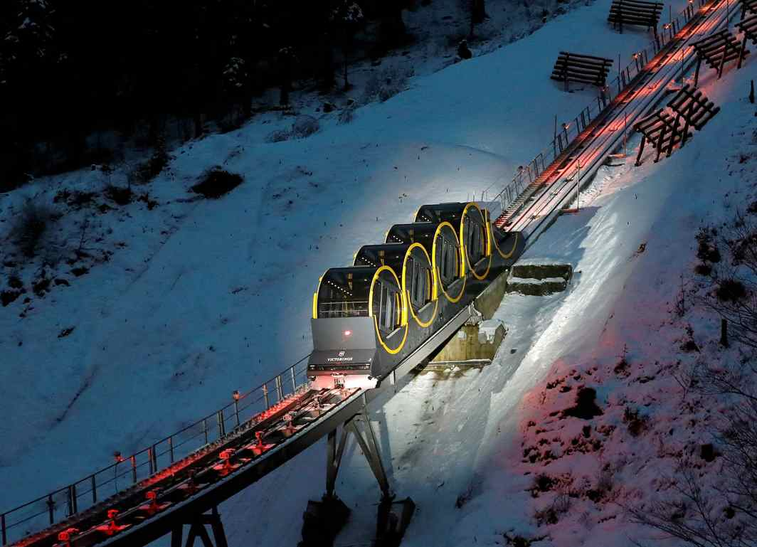 TOURIST TRAIN: The barrel-shaped carriages of a new funicular line are seen on the illuminated track before the opening ceremony near the Alpine resort of Stoos, Switzerland, Reuters/UNI