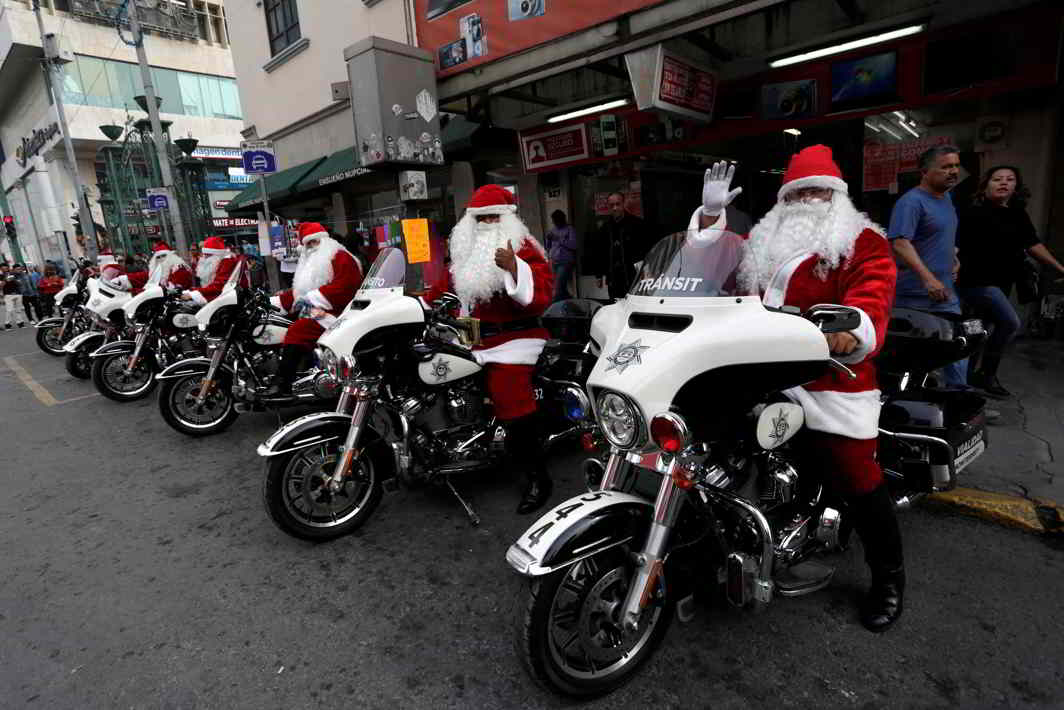 VROOM: Members of the transit police dressed as Santa Claus sit on their motorcycles in downtown Monterrey, Mexico, Reuters/UNI