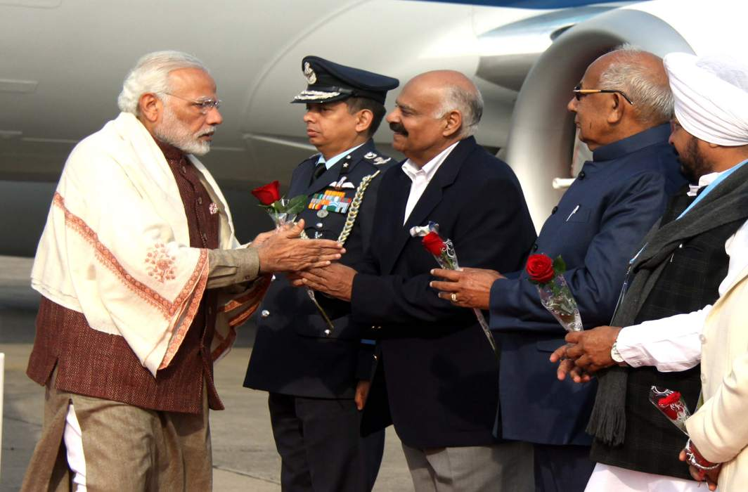 BON VOYAGE: Prime Minister Narendra Modi being received by the Governor of Punjab and Administrator, Union Territory, Chandigarh, VP Singh Badnore, at Chandigarh airport on way to Shimla, UNI