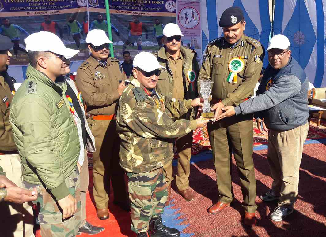 HONOURED: A Padma Kumar, Commandant, 33 Bn CRPF presents a memento to Col D D Panday, 4 RR which was the chief guest at the inaugural function of the football tournament being organised by CRPF under civic action at college ground in Bhaderwah, in Jammu and Kashmir, UNI