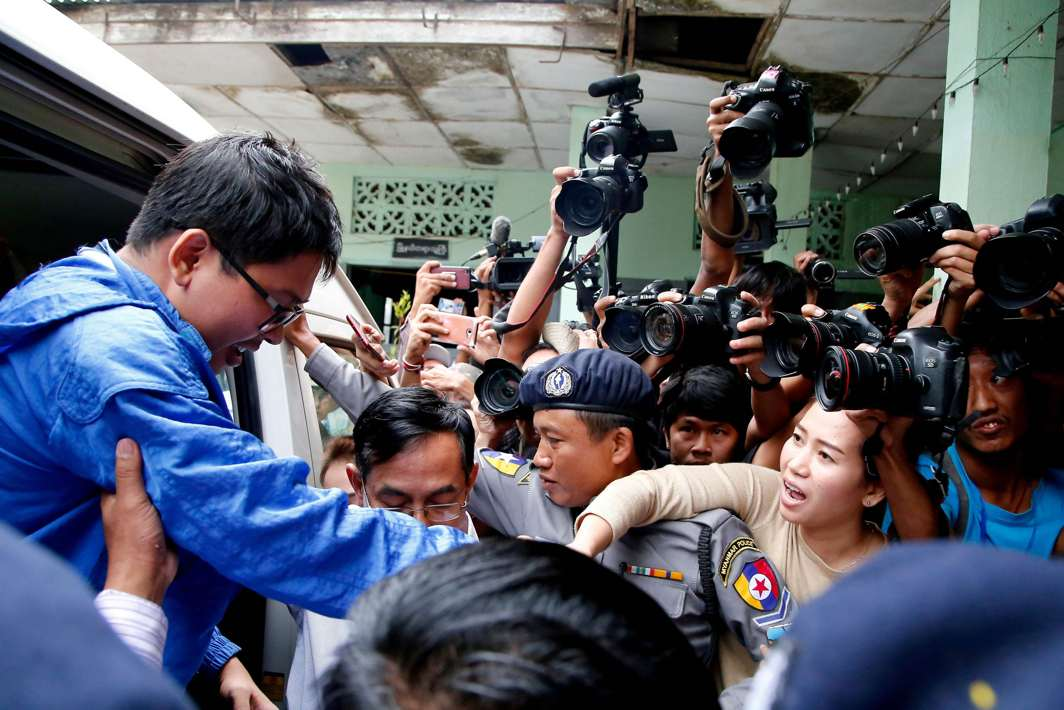 TRIED AND TESTED: Reuters reporter Wa Lone's wife Pan Ei Mon (2nd-R) tries to hold his hand as he arrives in court in Yangon, Myanmar, Reuters/UNI