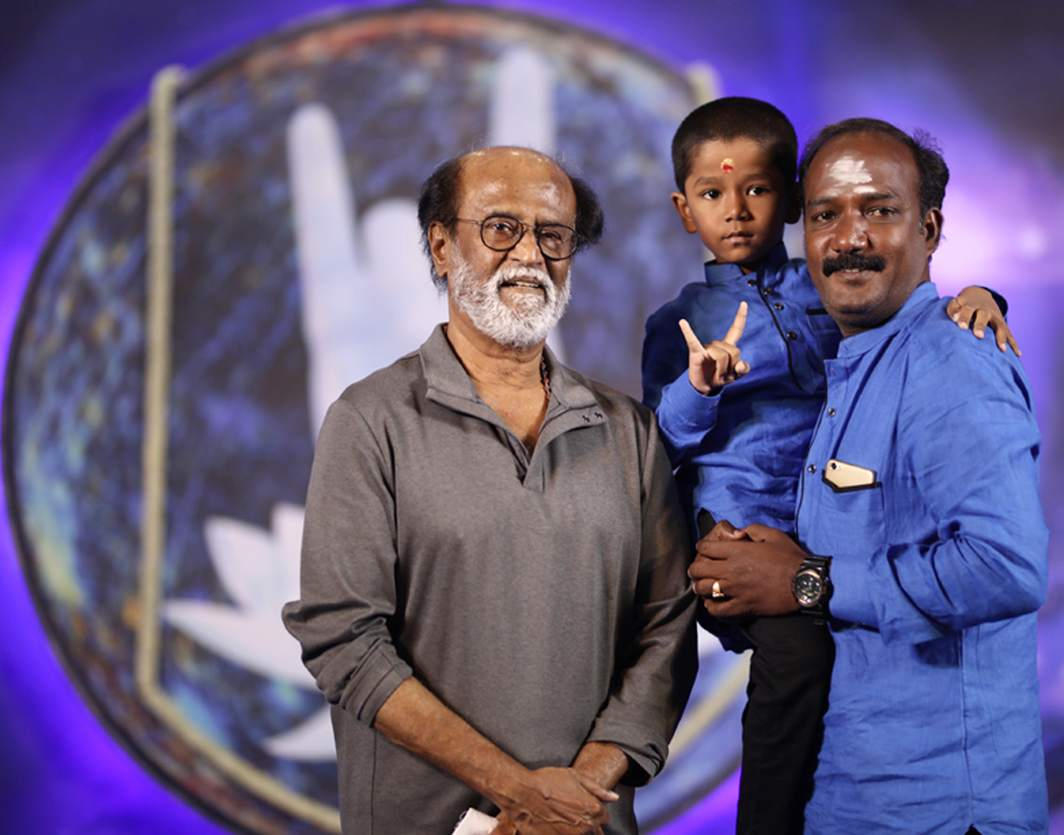 PHOTO OP: A fan of actor Rajinikanth taking a photo with him in Chennai, UNI