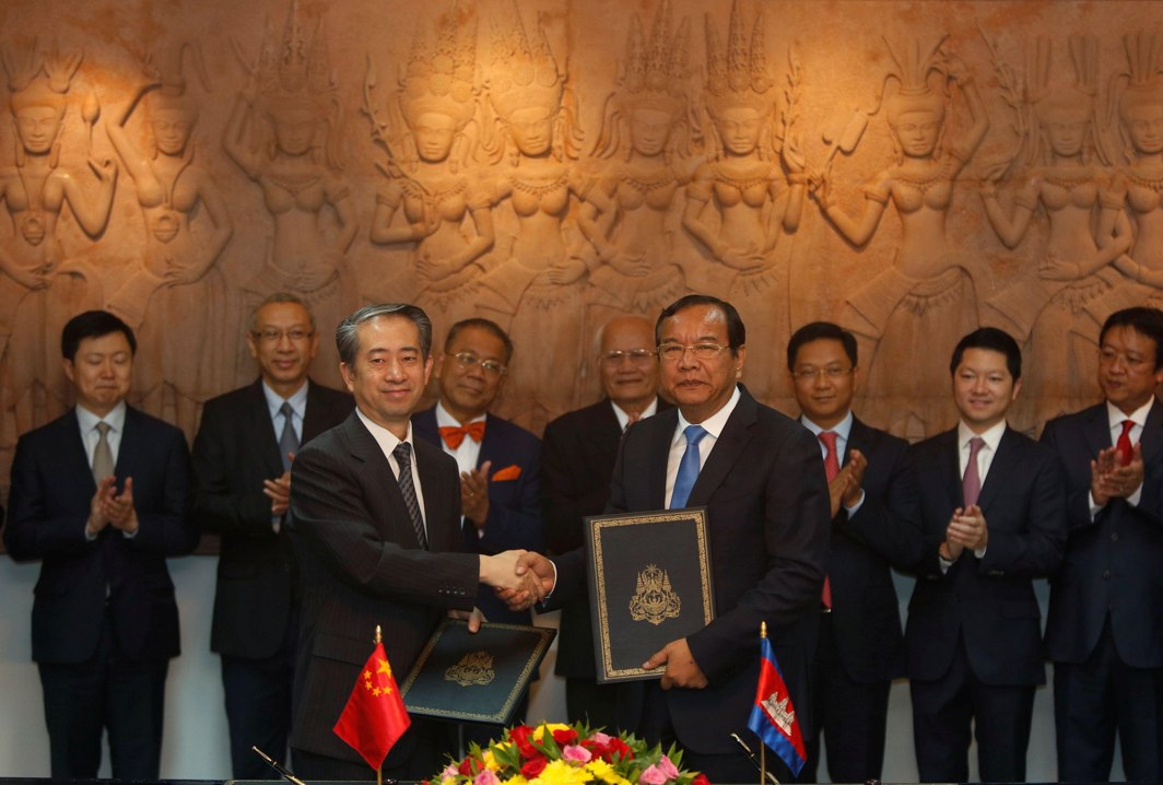 COLLABORATION: China's Ambassador to Cambodia Xiong Bo (left) shakes hands with Cambodia's Foreign Minister Prak Sokhon during signing of a new Chinese aid deal worth some $7 million for 16 projects as part of the Lancang-Mekong cooperation special fund, in Phnom Penh, Cambodia, Reuters/UNI