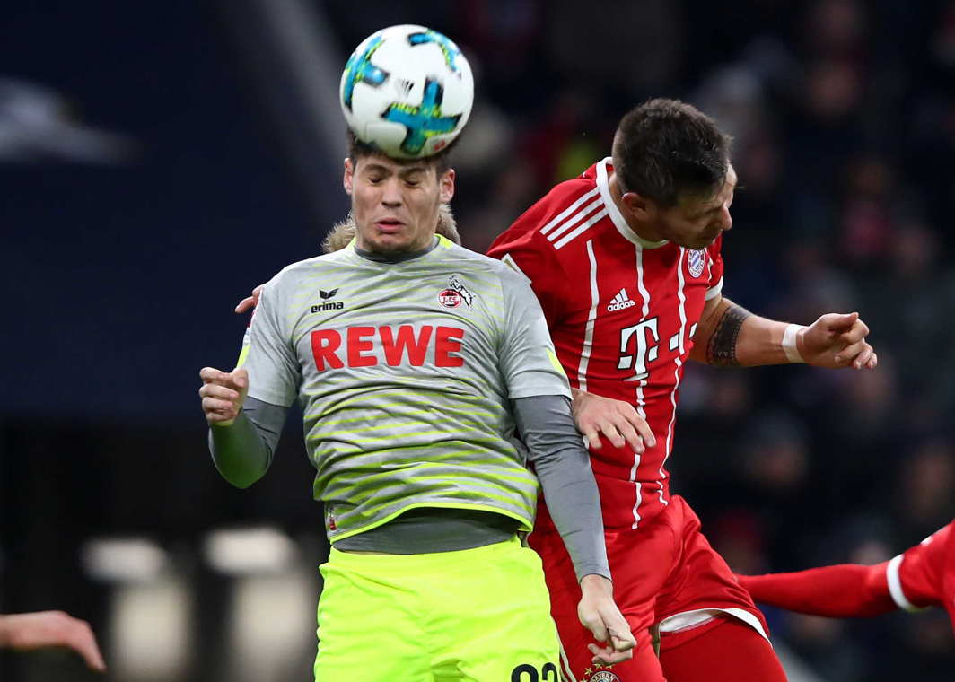 BEAUTIFUL GAME: Cologne's Jorge Mere in action against Bayern Munich's Niklas Sule during a Bundesliga match in Munich, Germany, Reuters/UNI