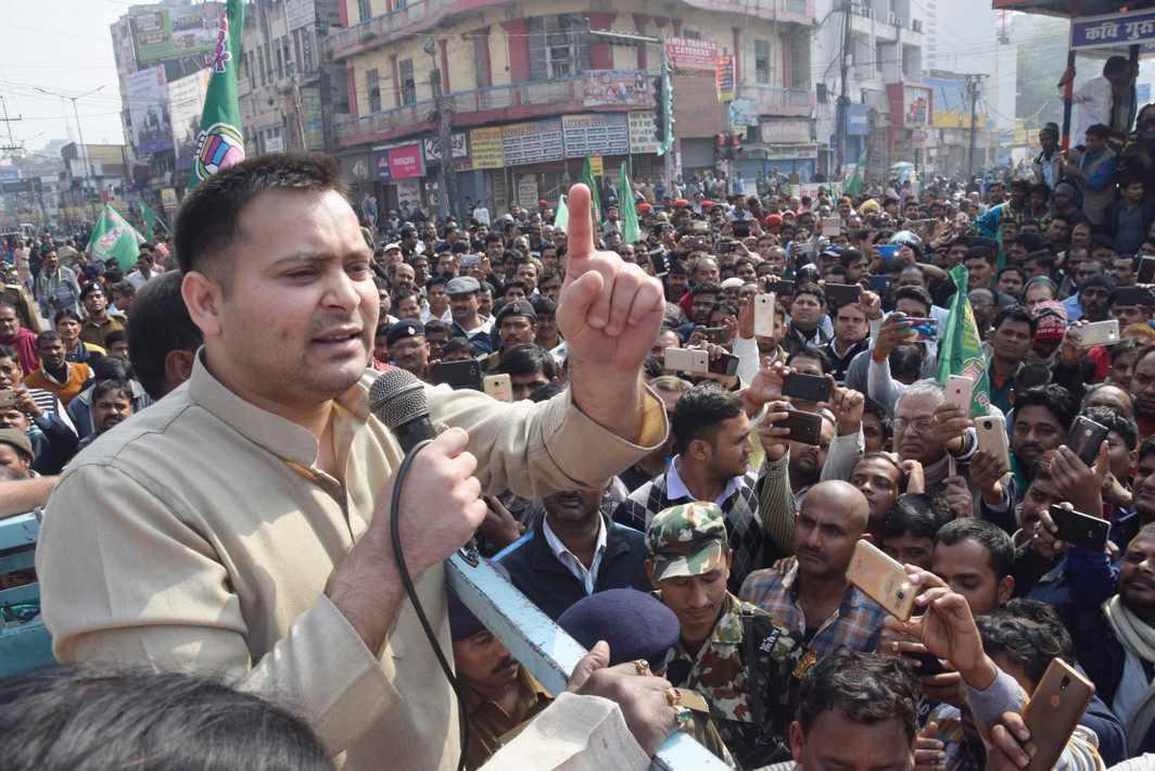DEFIANT IN DISTRESS: Rashtriya Janta Dal (RJD) leader and Bihar assembly leader of opposition Tejaswi Yadav address supporters during Bihar Bandh in Patna, UNI
