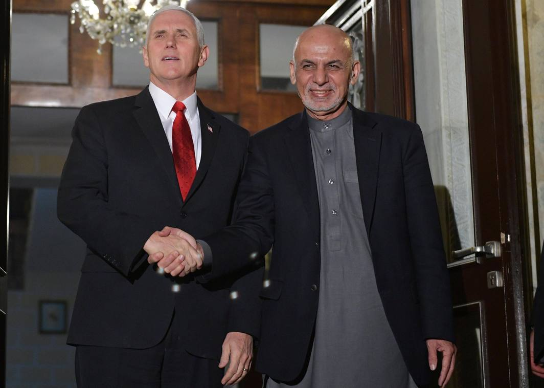HAIL FELLOW: US Vice-President Mike Pence (left) poses with Afghan President Ashraf Ghani upon arrival at the Presidential Palace in Kabul, Afghanistan, Reuters/UNI