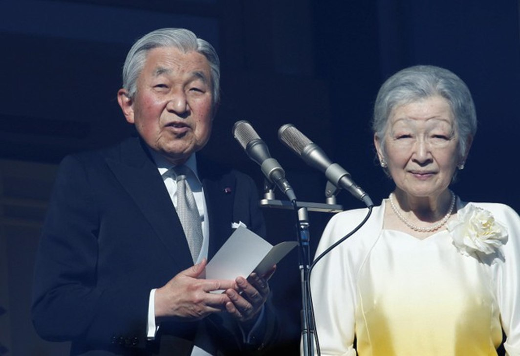 ON THE CLOCK: Japan's Emperor Akihito (left) makes a speech next to Empress Michiko during a public appearance for new year celebrations at the Imperial Palace in Tokyo, Japan, Reuters/UNI