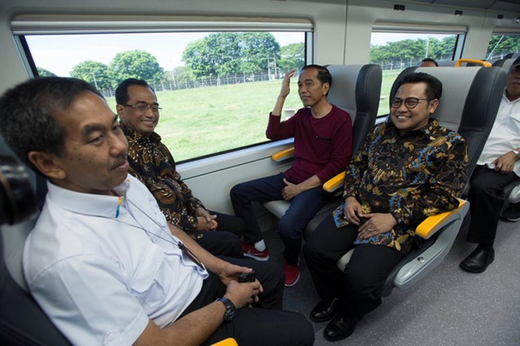 GO GO GO: Indonesia's President Joko Widodo (second right) sits on the airport rail link during a launch ceremony in Tangerang, Indonesia, Reuters/UNI