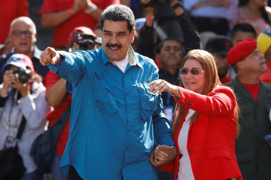UNCHALLENGED: Venezuela's President Nicolas Maduro gestures as he arrives for a rally to commemorate the 60th anniversary of the end of Venezuelan dictator Marcos Perez Jimenez's regime, with his wife Cilia Flores, in Caracas, Reuters/UNI