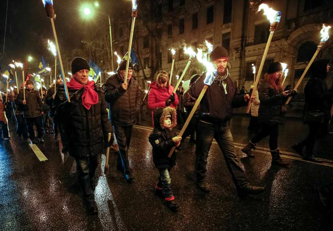 PRICE OF SOVEREIGNTY: Activists and supporters of the Svoboda (Freedom), a Ukrainian nationalist party, take part in a march with torches to honour several hundred students who died during a battle on January 29, 1918, while defending the Ukrainian capital from the Bolsheviks, in Kiev, Ukraine, Reuters/UNI