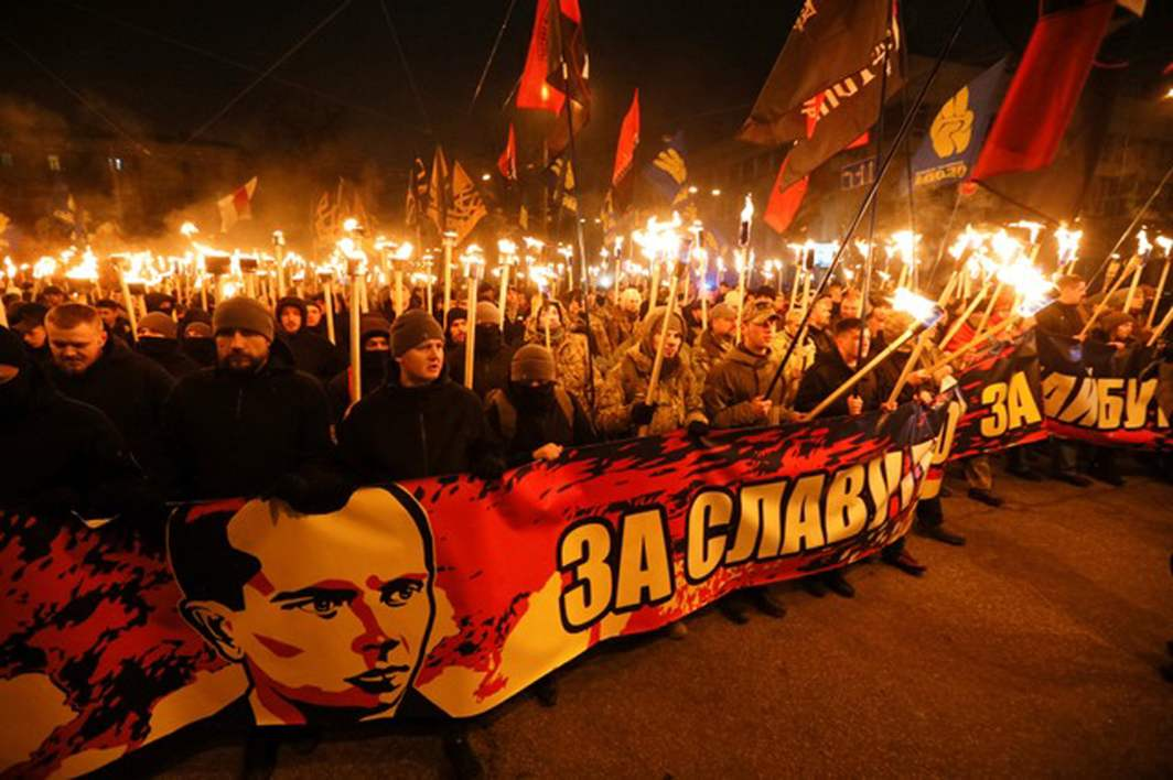 PASSIONS RISING: Activists of Ukrainian nationalist parties hold torches as they take part in a rally to mark the 109th anniversary of the birth of Stepan Bandera, one of the founders of the Organization of Ukrainian Nationalists (OUN), in Kiev, Reuters/UNI