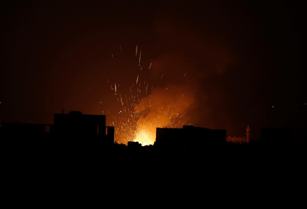 NONSTOP DESTRUCTION: A Houthi arms depot explodes after it was hit by air strikes in Sanaa, Yemen, Reuters/UNI