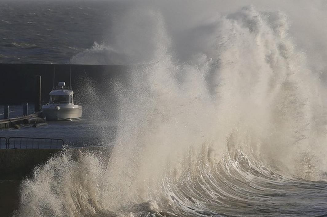 LOUD AND NEAR: A high wave crashes on the protecting wall at the fishing harbour in Pornic, France, as Storm Carmen hits the French Atlantic coast, Reuters/UNI