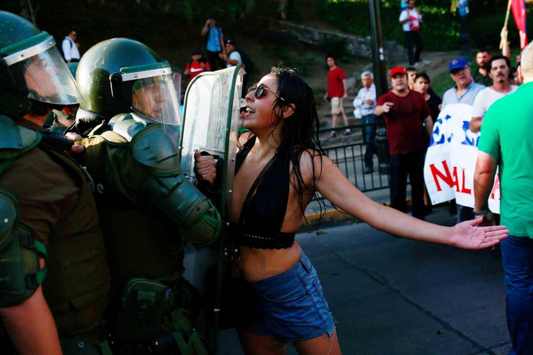 FORWARD MARCH: A demonstrator confronts riot police during a rally in defence of the nationalisation of lithium reserves in the country, in Santiago, Chile, Reuters/UNI