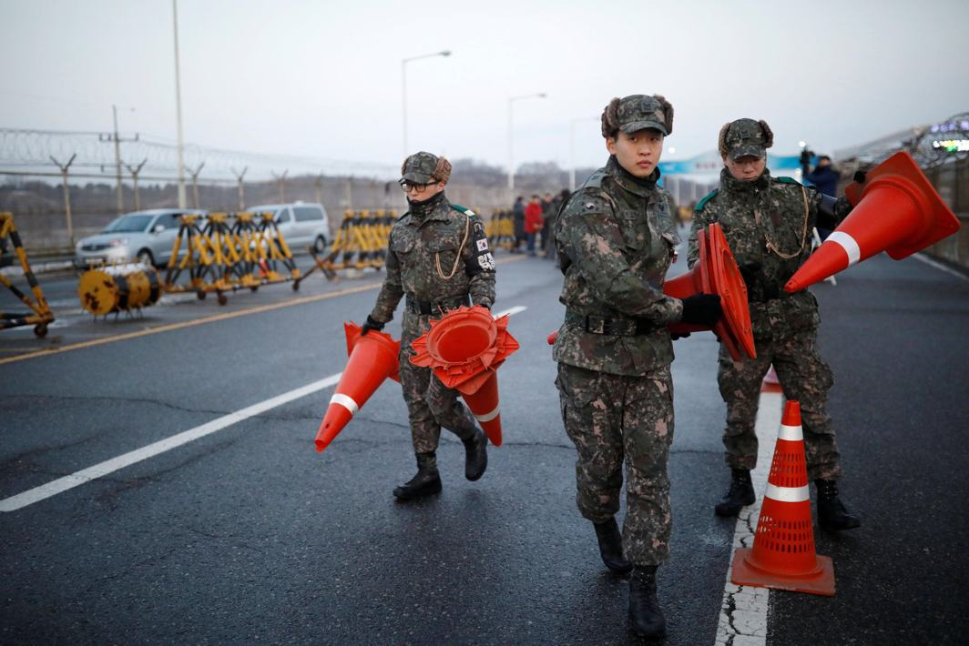 DRAWING THE LINE: South Korean soldiers place traffic cones at a checkpoint on the Grand Unification Bridge that leads to the truce village of Panmunjom, just south of the demilitarised zone separating the two Koreans, in Paju, South Korea, Reuters/UNI