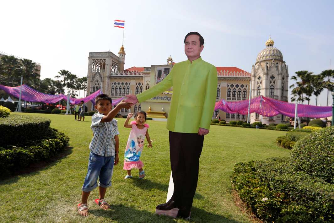 UNCLE PM: Children play next to a cardboard cutout of Thailand's Prime Minister Prayuth Chan-ocha during Children's Day celebrations at Government House in Bangkok, Thailand, Reuters/UNI