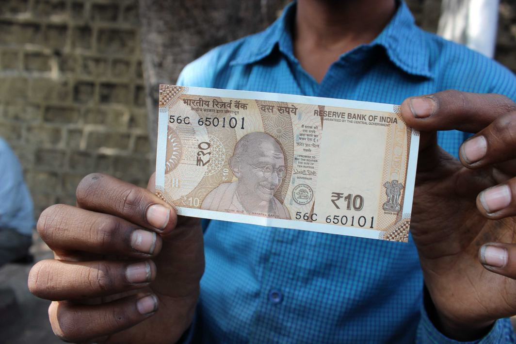 CHECK IT OUT: A person shows a new rupee 10 currency note outside Reserve Bank of India (RBI) in Hyderabad, UNI