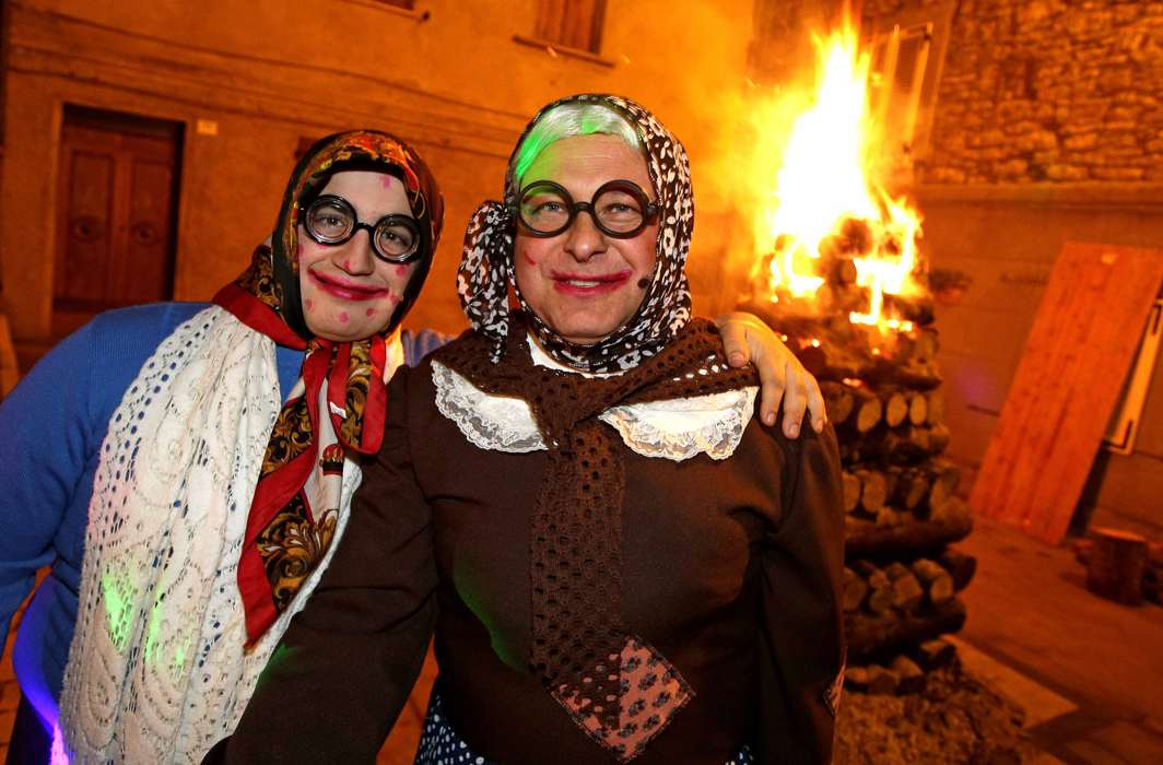 """CROSS-DRESS: People dressed as """"Befane"""" pose in Castell'Azzara, Italy, Reuters/UNI"""