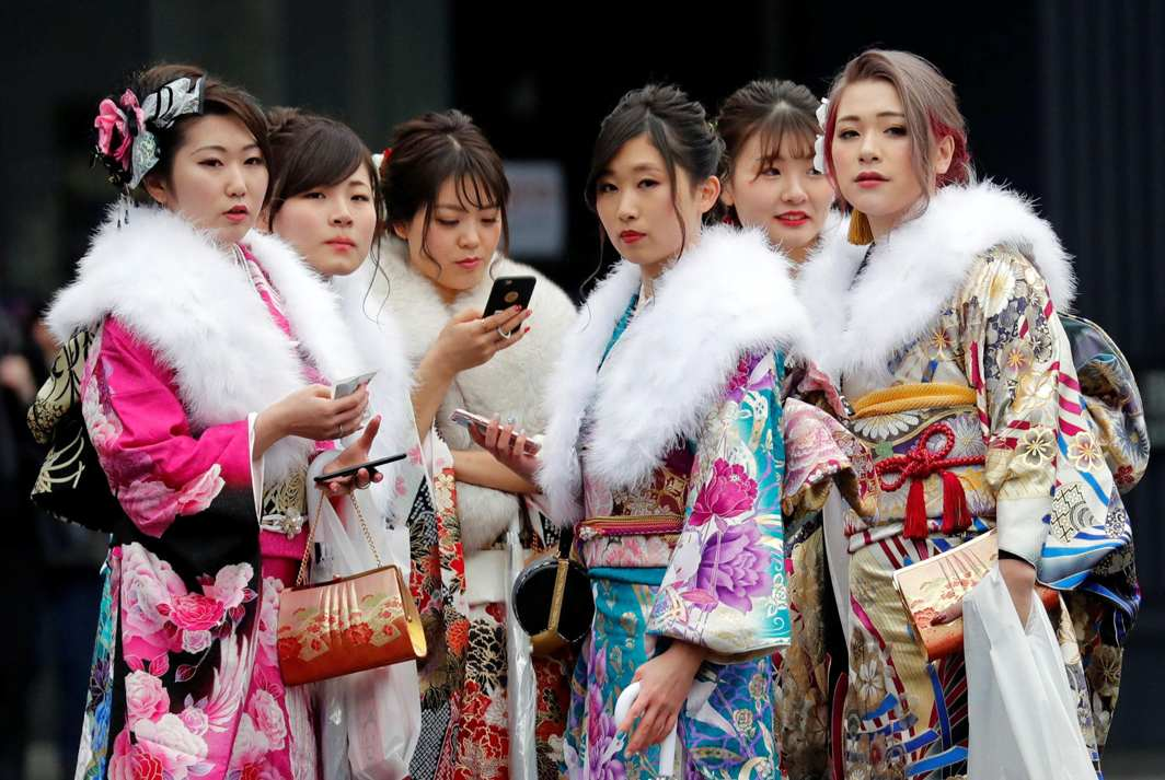 GIRLS TO WOMEN: Japanese women wearing kimonos attend their Coming of Age Day celebration ceremony at an amusement park in Tokyo, Japan, Reuters/UNI