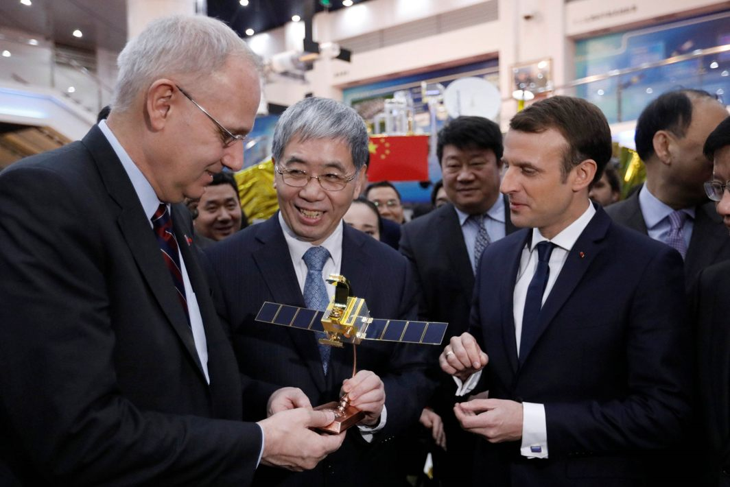 TAMING THE DRAGON: French President Emmanuel Macron (R) and Jean-Yves Le Gall (L) President of the Centre National d'Etudes Spatiales (CNES) receive a scale model of the CFOSAT (China-France Oceanography SATellite) during a visit to the China Academy of Space Technology in Beijing, China, Reuters/UNI
