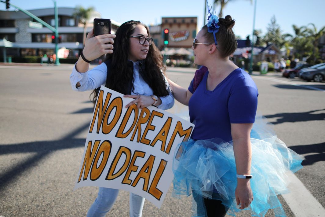 SUPPORT FOR DREAMERS: A woman visiting Disneyland hugs a protester outside Disneyland in Anaheim, California US, Reuters/UNI