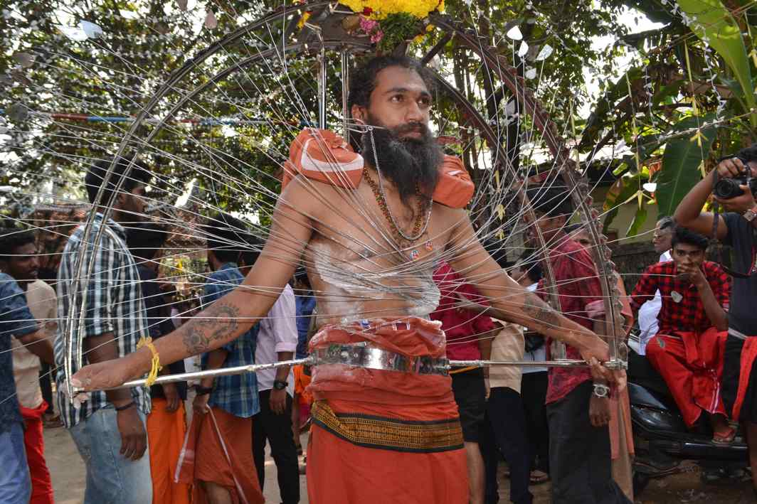 PICTURE OF PENANCE: A man carries a decorated kavad on the occasion of Thaipusam festival in Thiruvananthapuram, UNI
