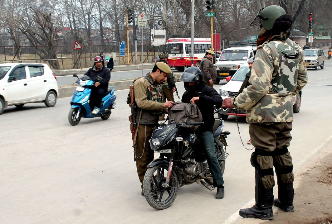 TIGHTEN THE NET: Security personnel search vehicles for possible transportation of arms and ammunition on a tip-off at Maulana Azad Road in Srinagar, UNI