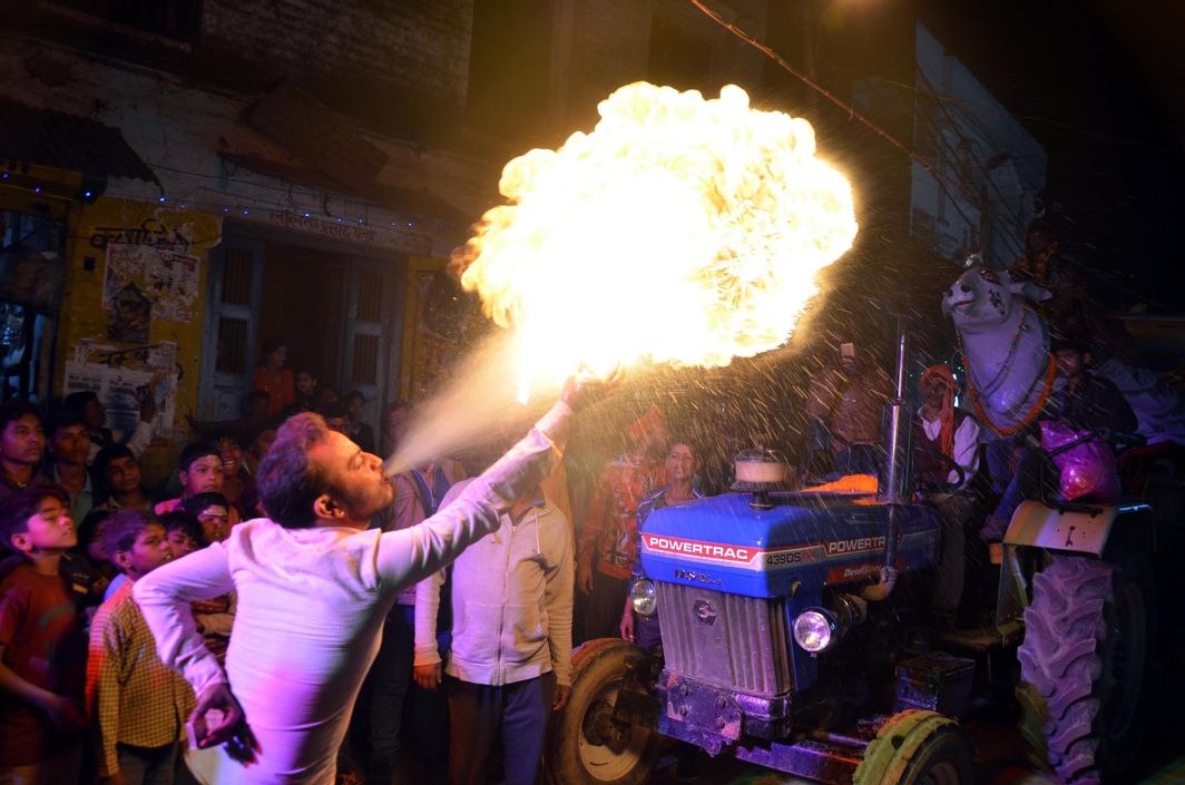 STREET ARTISTE: A fire-blowing artiste performs during a religious procession on the occasion of Maha Shivratri festival at Vindhyachal Dham in Mirzapur, Uttar Pradesh, UNI