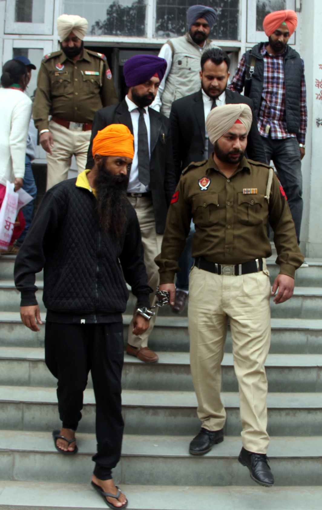 FACE THE CONSEQUENCES: Gurdev Singh Tanda, allegedly a member of Sikh separatist outfit Khalistan Liberation Force, is taken to court after his arrest from Thailand by Punjab Police Operation Cell, in Amritsar, UNI