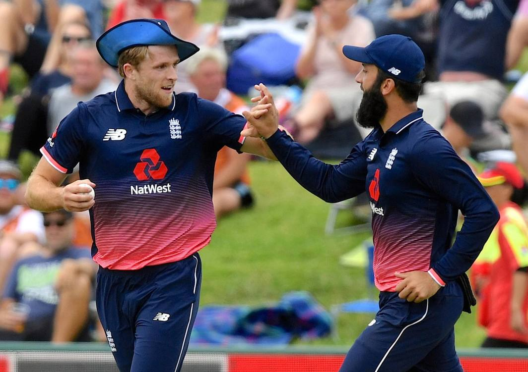 HOWZZAT: England's David Willey celebrates with teammate Moeen Ali after taking a catch to dismiss New Zealand's Mark Chapman during their one-day international match, at Bay Oval, Tauranga, New Zealand, Reuters/UNI
