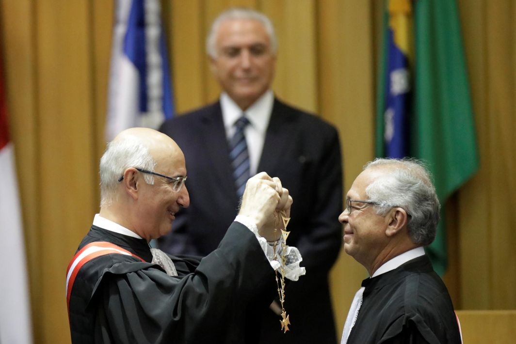 TOKEN OF HONOUR: Former president of the Superior Labor Court Ives Gandra Martins puts an honorific medal on the new court president, Joao Batista Brito, during a ceremony in Brasilia, Brazil, Reuters/UNI