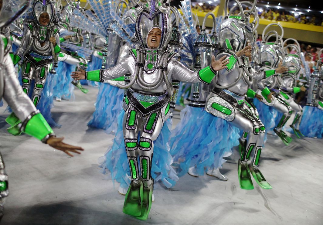 PRETTY ANDROIDS: Revellers from Vila Isabel Samba school perform during the first night of the Carnival parade at the Sambadrome in Rio de Janeiro, Brazil, Reuters/UNI